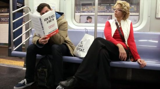 Funny! Prankster Reads Books With Fake Covers On Subway