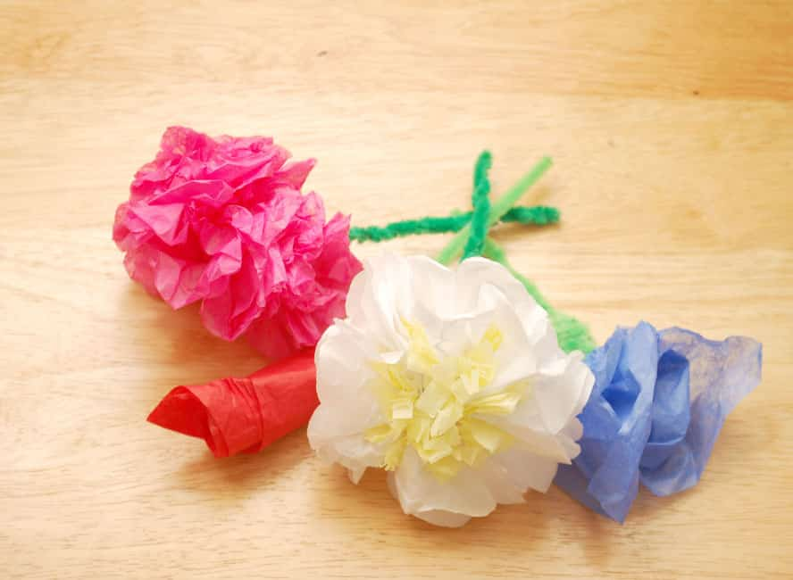 With a little more time and effort, you could also make tri-color tissue paper flowers: Heck, you can even turn a paper flower into a tissue paper jellyfish: And if you need resources for buying tissue paper in bulk to make this paper flowers DIY, I have you covered.