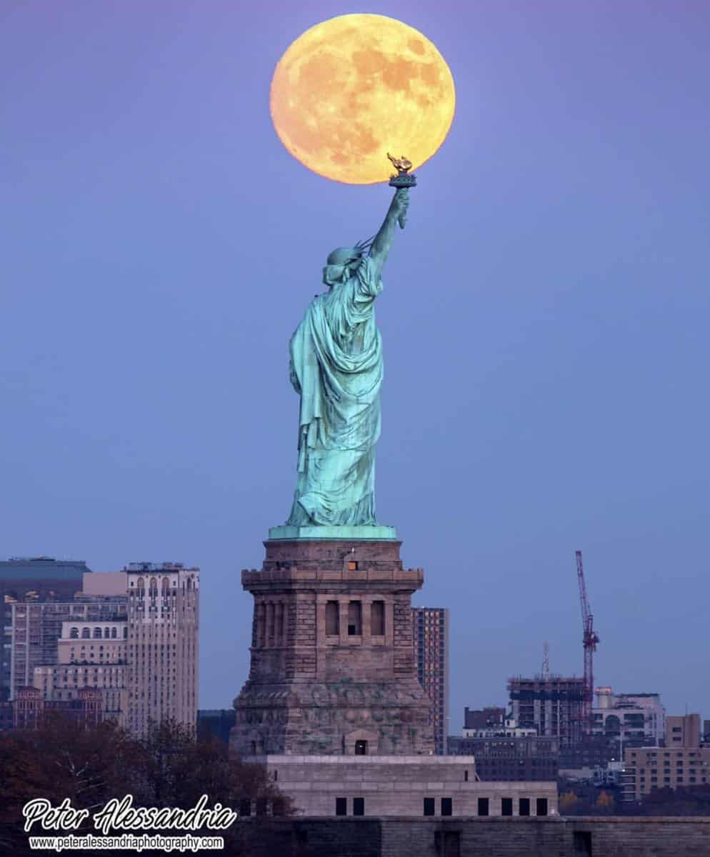 supermoon over statue of Liberty