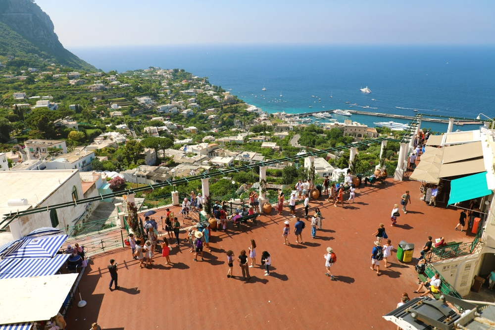 CAPRI, ITALY, aerial view of Capri Piazzetta square with tourists taking pictures from beautiful panoramic viewpoint, Capri, Italy