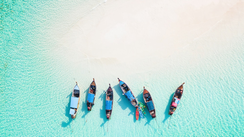 12 Sunny Beaches Around the World to Float in Luxury