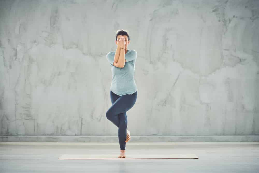 Eagle Pose will test your balance and core strength